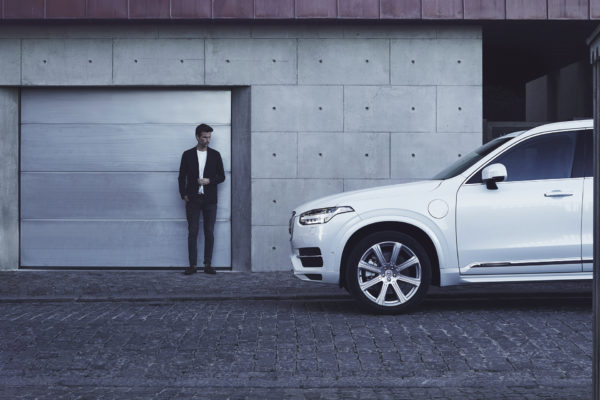 Man standing next to a volvo
